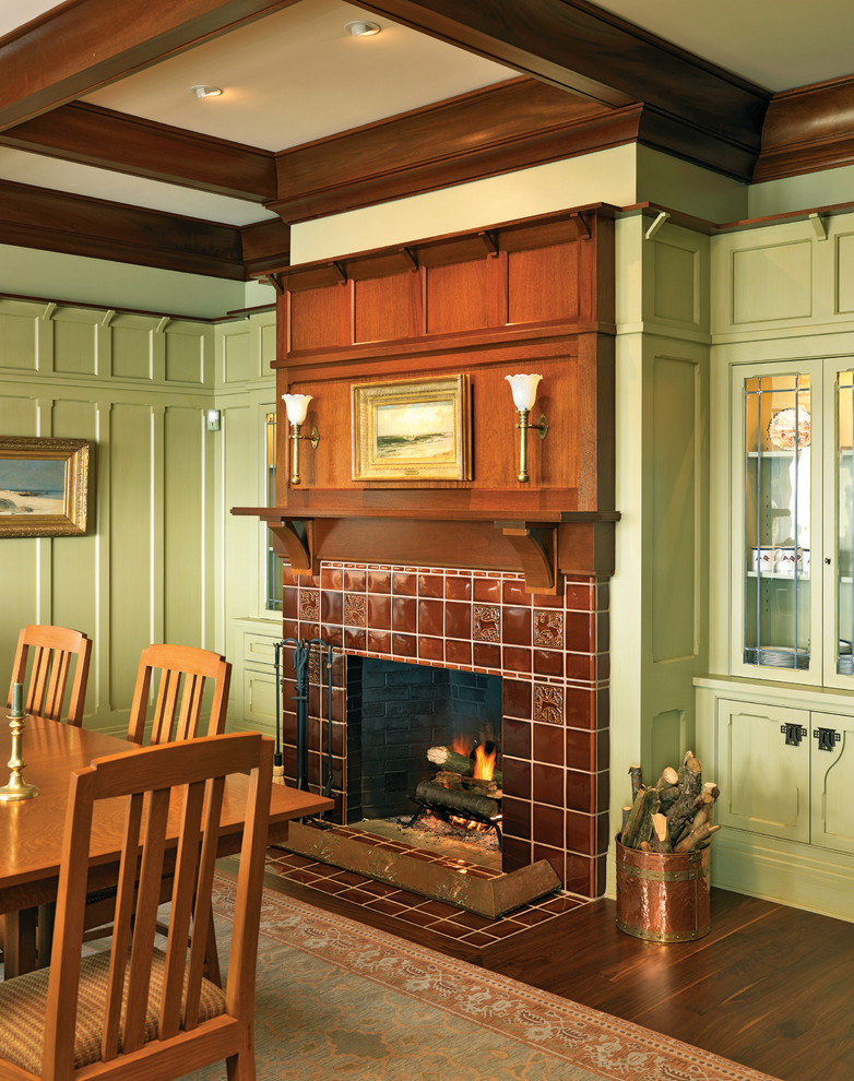 Enclosed dining room - large craftsman dark wood floor enclosed dining room idea in Providence with green walls, a standard fireplace and a tile fireplace