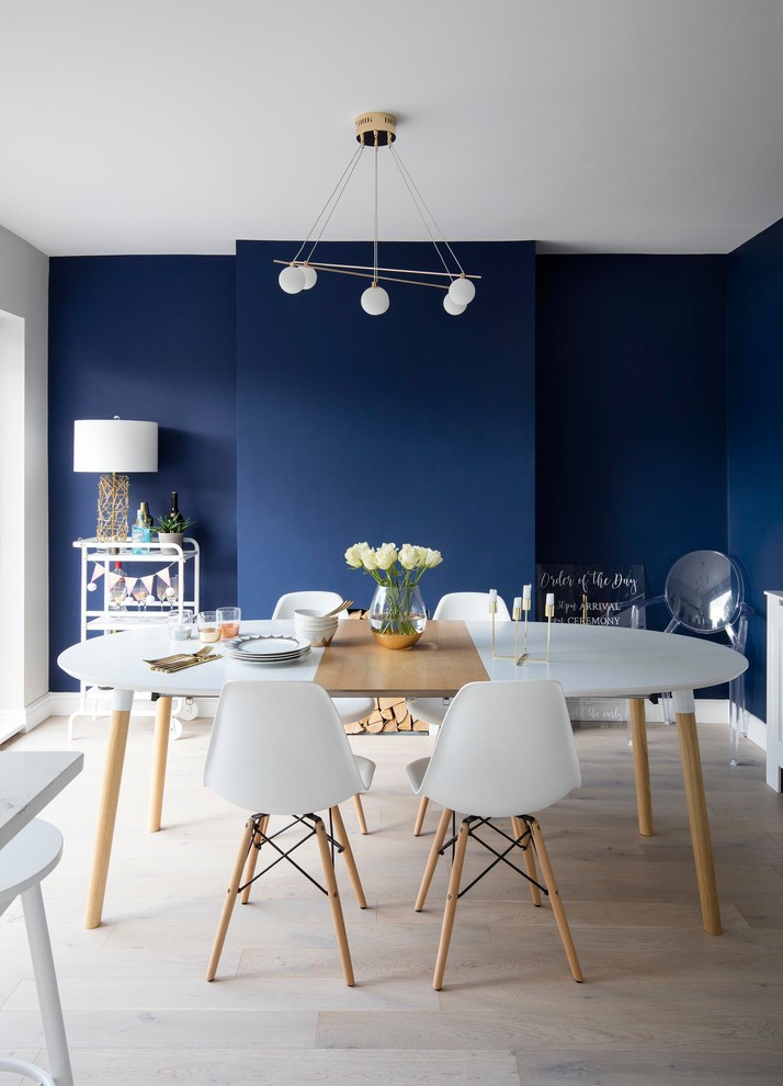 Inspiration for a scandinavian light wood floor and beige floor dining room remodel in Other with blue walls and no fireplace