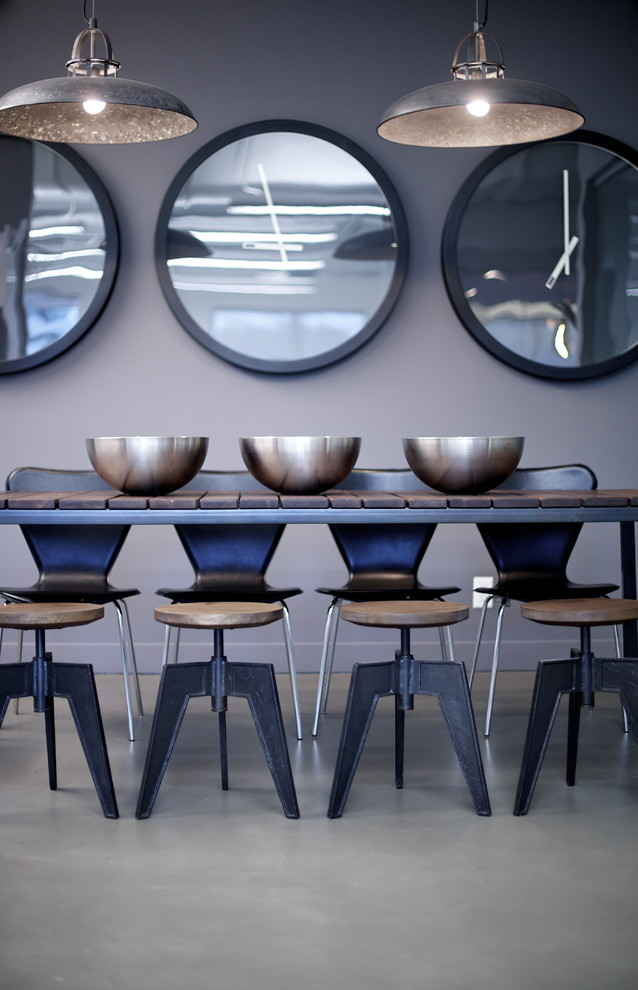 Inspiration for a modern concrete floor dining room remodel in Vancouver with gray walls