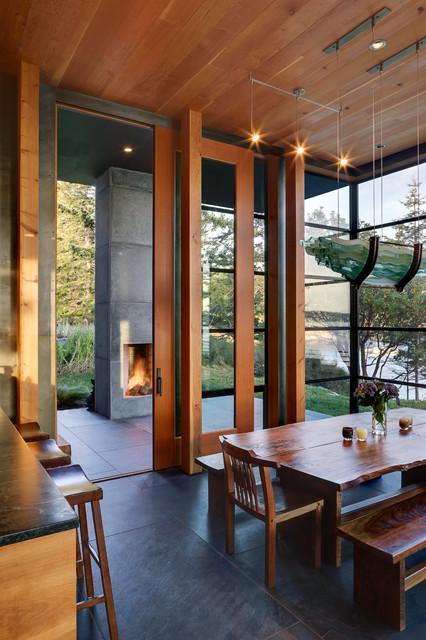 Mid-sized minimalist slate floor kitchen/dining room combo photo in Seattle