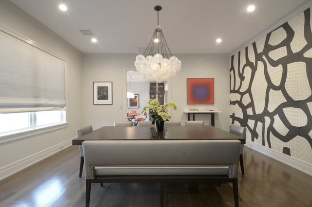 Inspiration for a contemporary dark wood floor dining room remodel in New York with multicolored walls