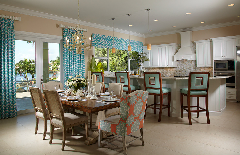 Inspiration for a timeless beige floor kitchen/dining room combo remodel in Miami with beige walls