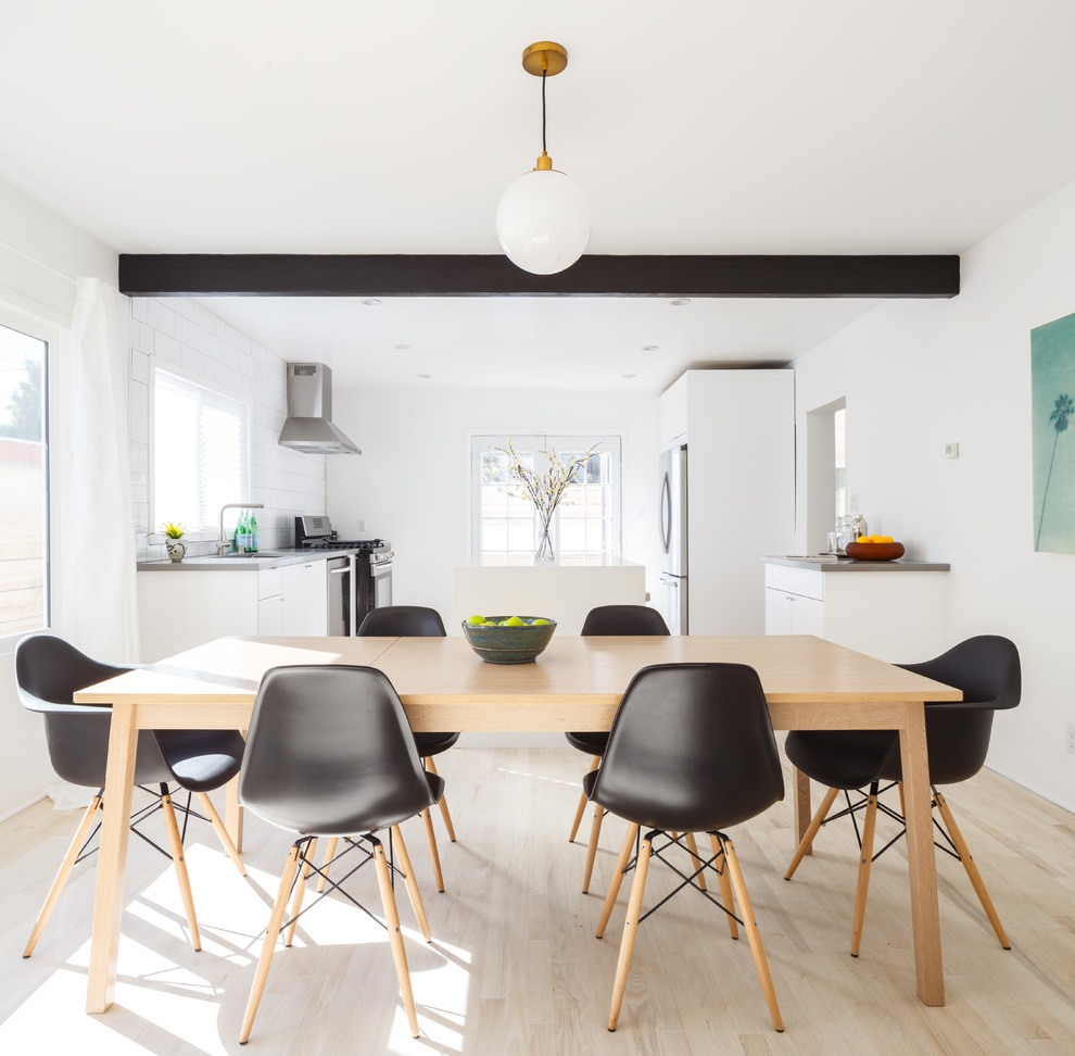 Example of a danish light wood floor dining room design in Los Angeles with white walls and no fireplace