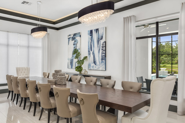 Large minimalist porcelain floor kitchen/dining room combo photo in Orlando with white walls and no fireplace