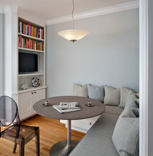 This casual styled breakfast nook space was designed to be multi-functional and practical. It serves as a place to read the paper, enjoy a good book, watch TV, play video games, do homework, have a family game night, store toys and games as well as enjoy a meal.