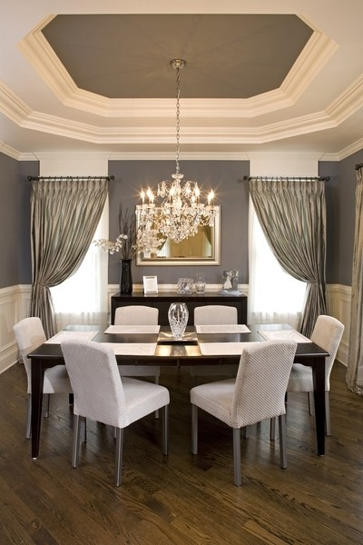 Example of a mid-sized dark wood floor enclosed dining room design in Chicago with gray walls
