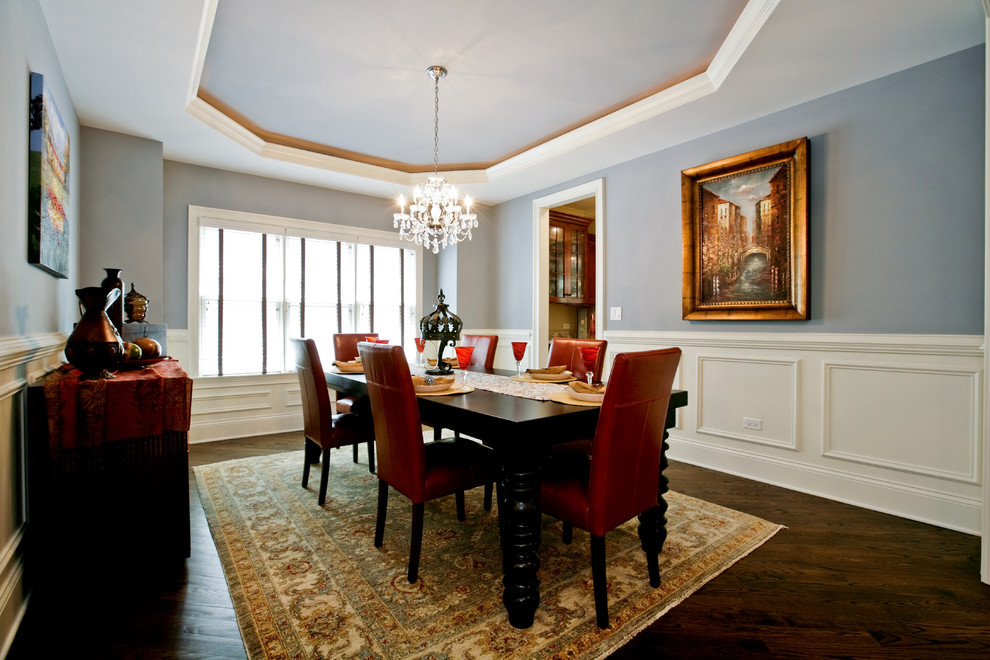 Enclosed dining room - mid-sized traditional dark wood floor and brown floor enclosed dining room idea in Chicago with gray walls and no fireplace