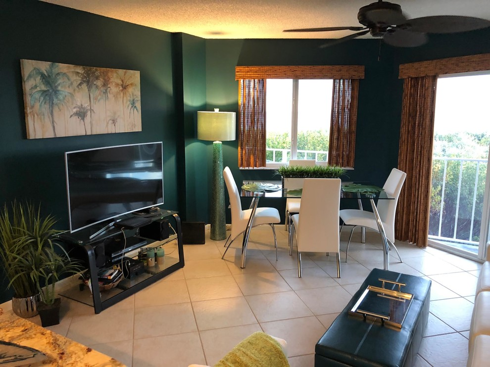 Mid-sized trendy ceramic tile and beige floor great room photo in Miami with blue walls and no fireplace