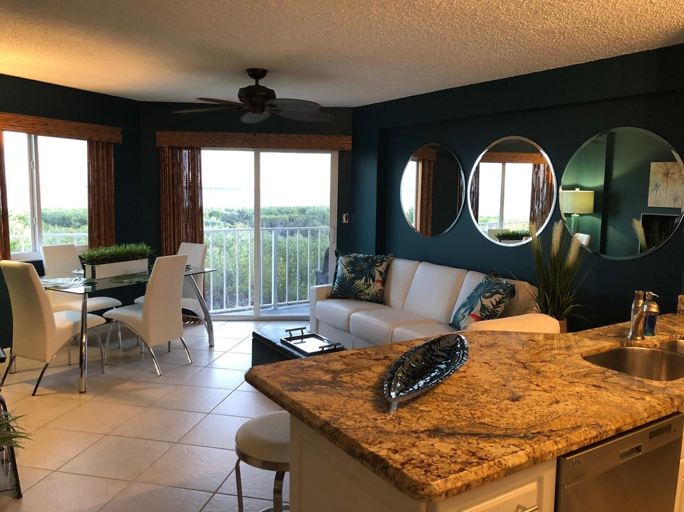 Example of a mid-sized trendy ceramic tile and beige floor great room design in Boston with blue walls and no fireplace