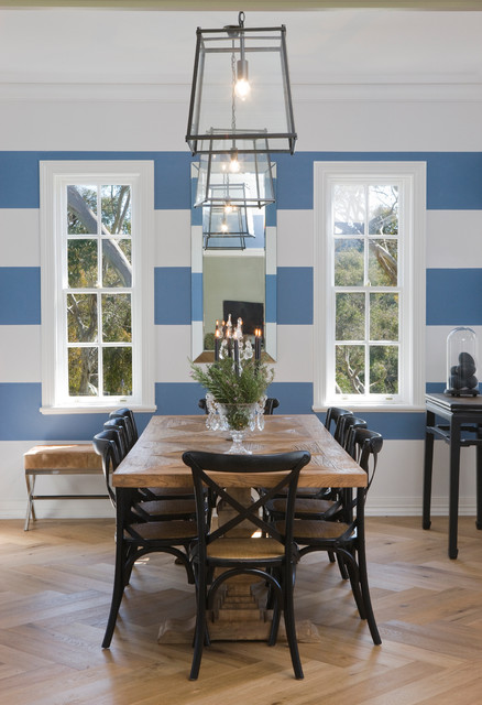 Inspiration for a transitional light wood floor dining room remodel in Adelaide with multicolored walls