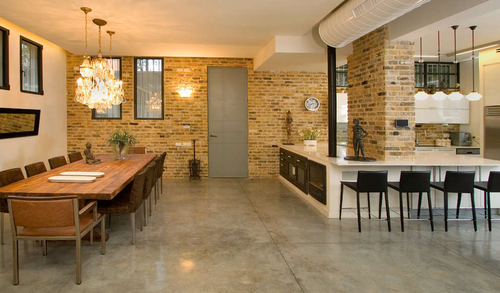 Dining room - industrial concrete floor dining room idea in Other