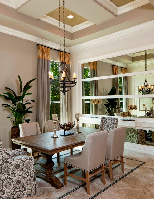 Inspiration for a timeless dining room remodel in Miami with gray walls