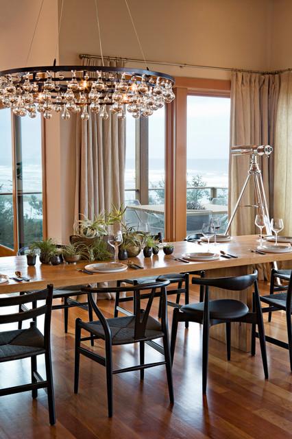 Trendy dark wood floor dining room photo in Portland with beige walls