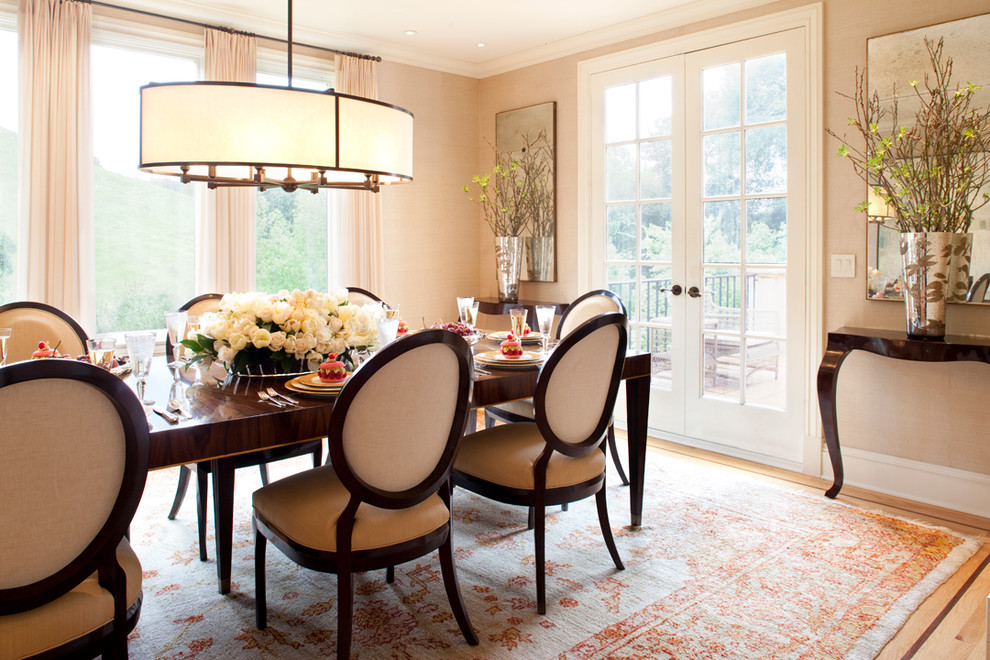 Enclosed dining room - mid-sized traditional light wood floor enclosed dining room idea in San Francisco with beige walls and no fireplace