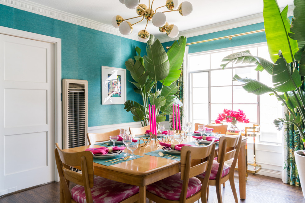 Inspiration for an eclectic vinyl floor and brown floor enclosed dining room remodel in Los Angeles with blue walls