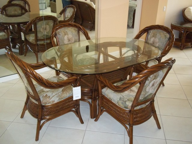 oval glass top dining table with rattan chairs tropical dining room