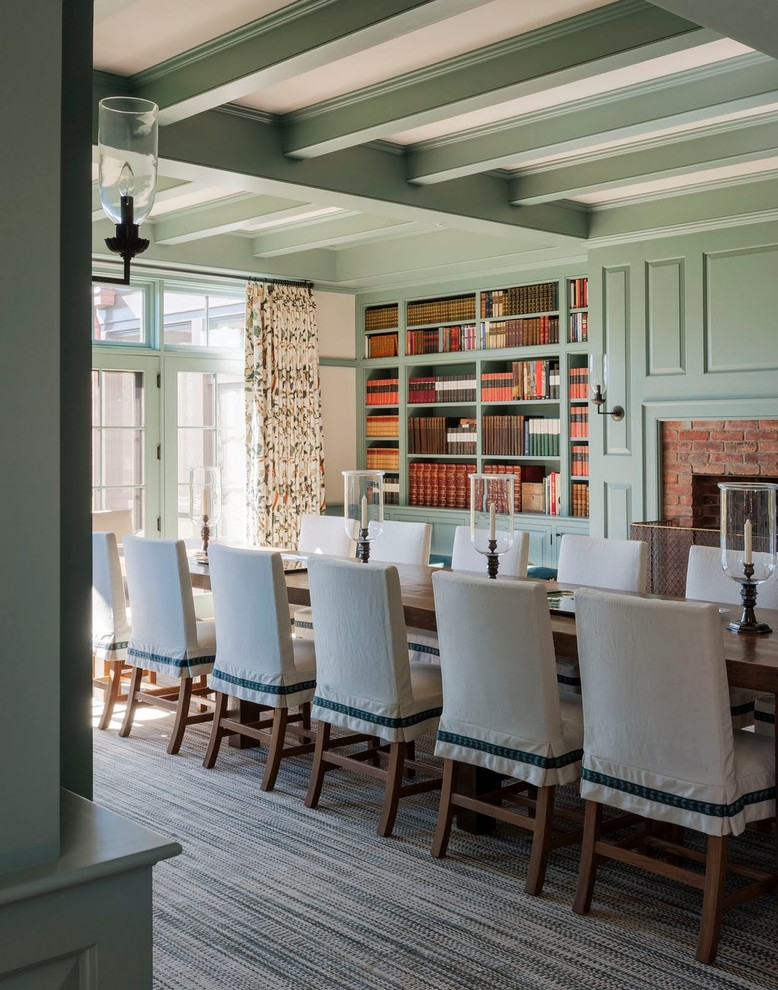 Inspiration for a huge timeless carpeted enclosed dining room remodel in Boston with green walls, a standard fireplace and a brick fireplace