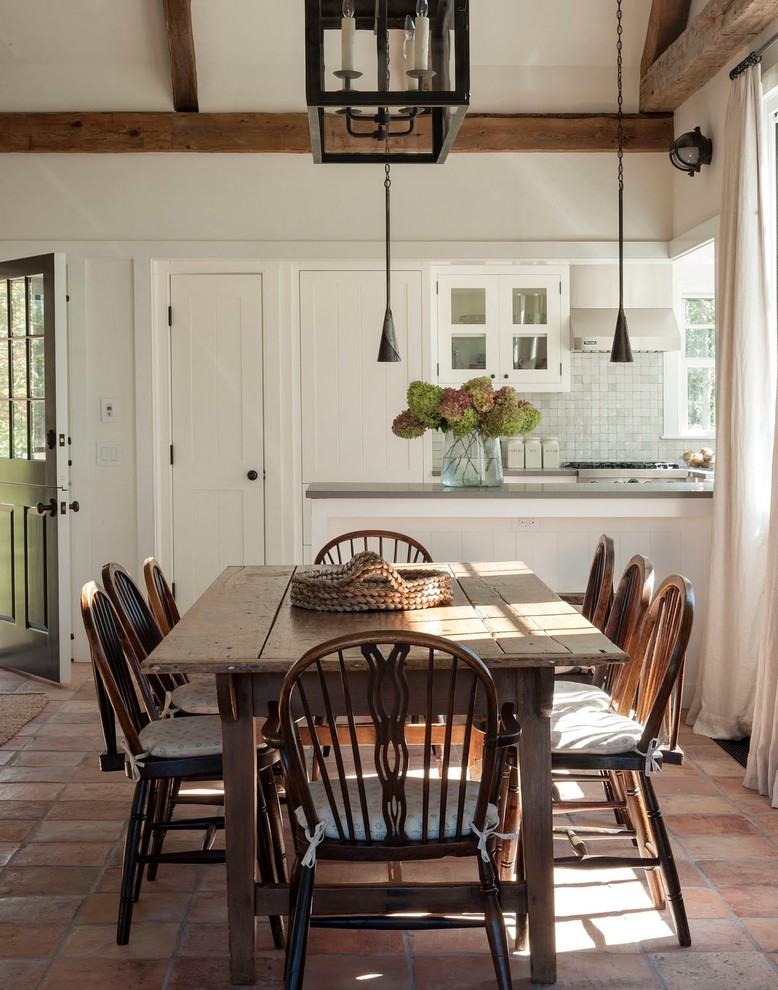 Example of a cottage dining room design in Boston with white walls
