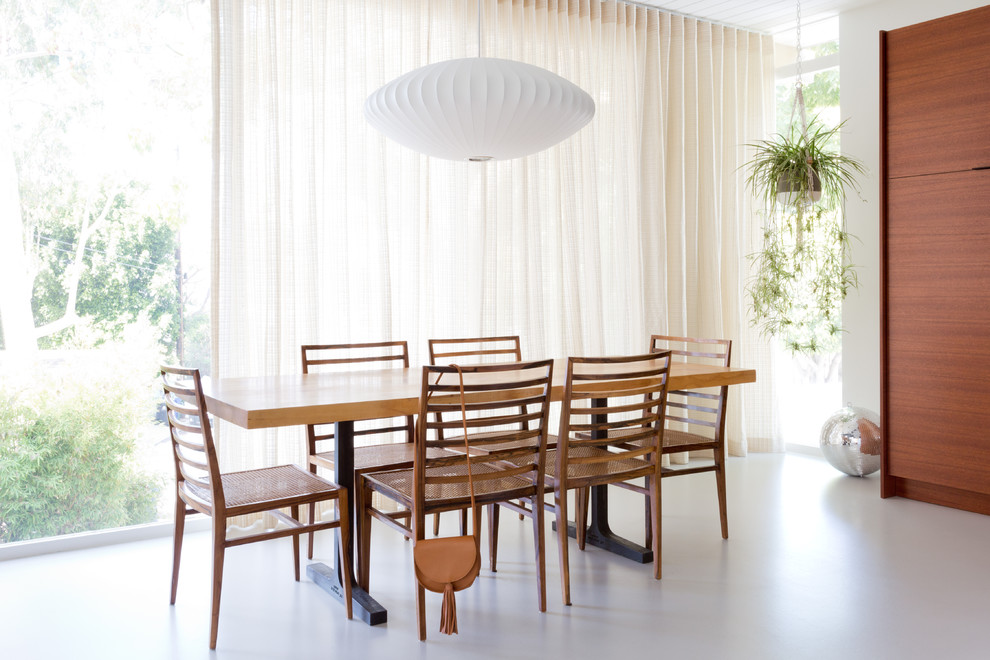 1950s white floor dining room photo in Los Angeles with white walls
