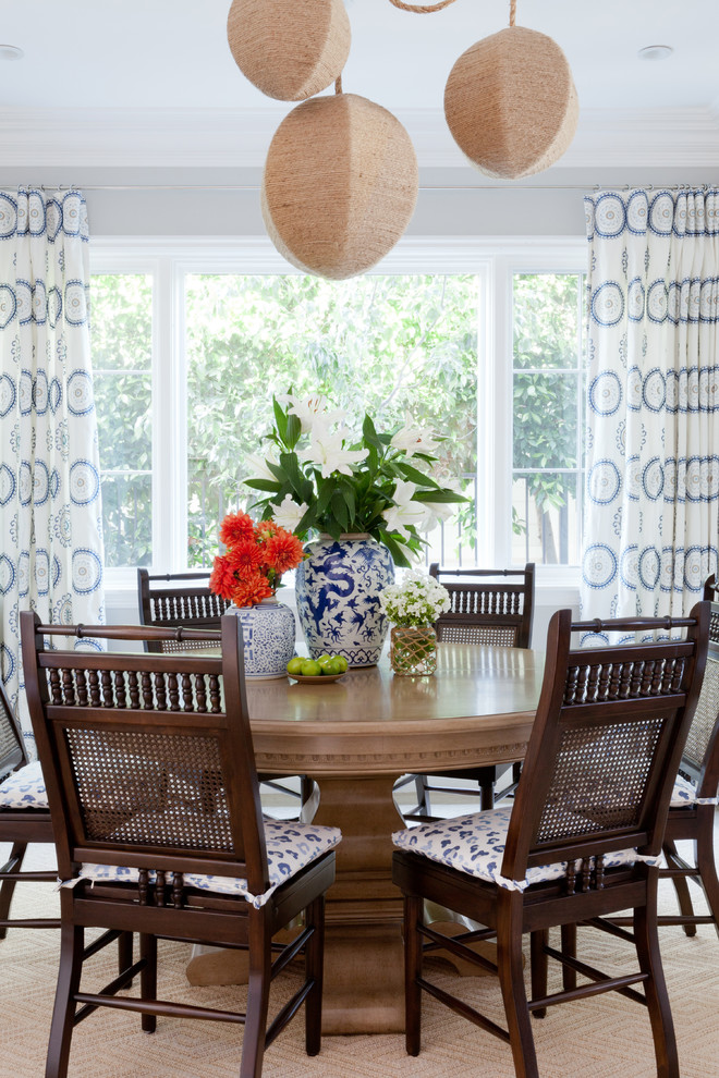 Beach style dining room photo in Los Angeles with gray walls
