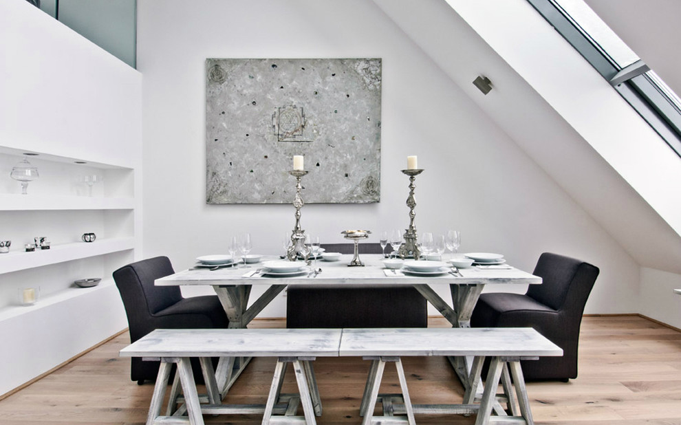 Trendy medium tone wood floor dining room photo in Other with white walls