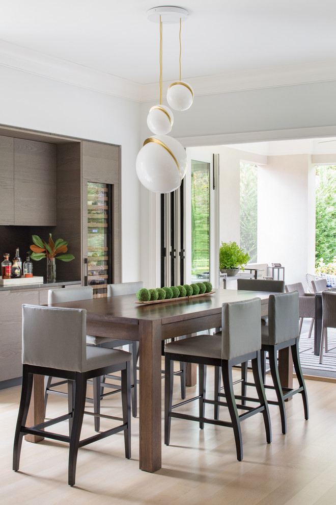 Kitchen/dining room combo - mid-sized contemporary light wood floor and beige floor kitchen/dining room combo idea in DC Metro with white walls and no fireplace