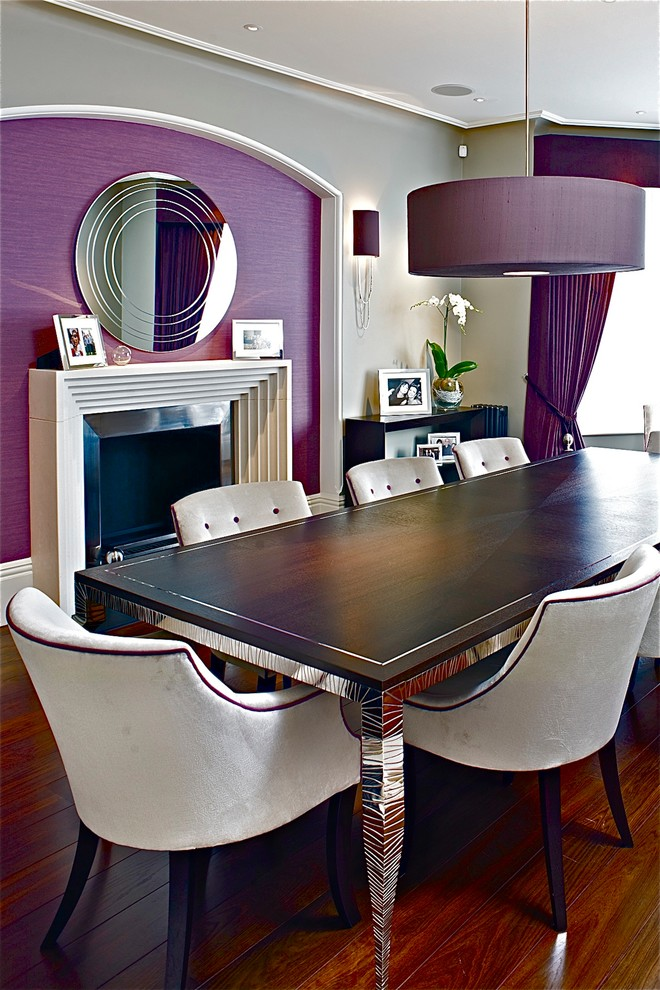 Inspiration for a contemporary dark wood floor dining room remodel in London with purple walls