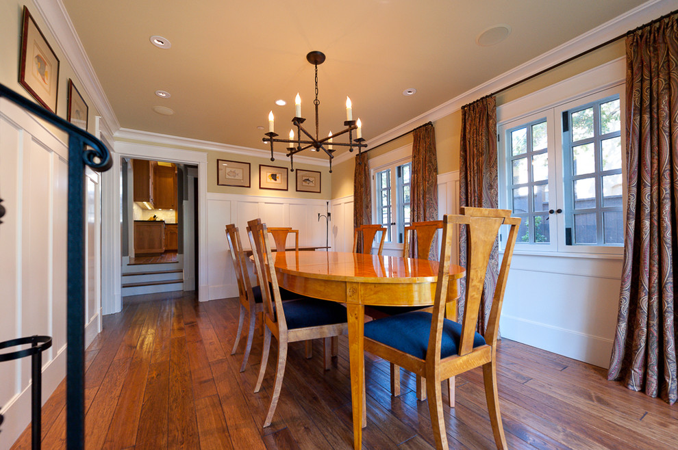 Example of a large classic dark wood floor and brown floor enclosed dining room design in San Francisco with beige walls and no fireplace