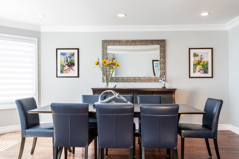 Great room - large eclectic medium tone wood floor great room idea in Los Angeles with gray walls