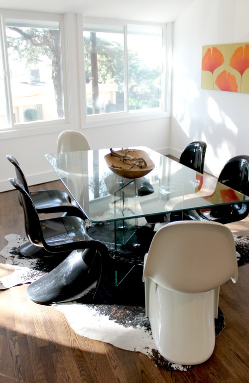 Panton S Chairs, Glass Dining Table, Cowhide Rug