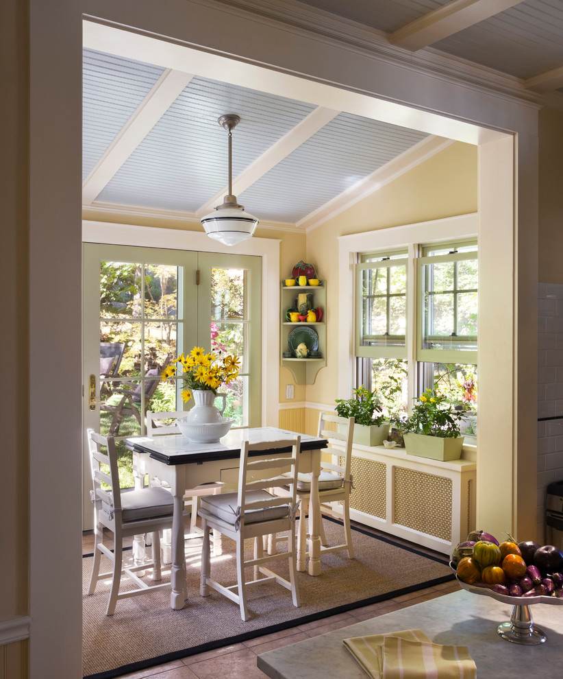 Inspiration for a timeless dining room remodel in New York with yellow walls