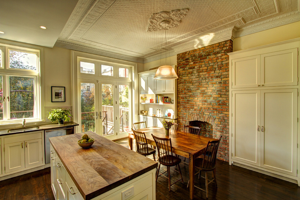 Kitchen/dining room combo - traditional brown floor kitchen/dining room combo idea in New York