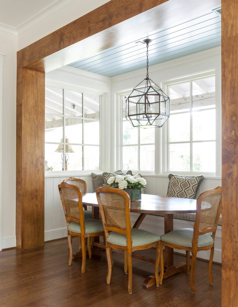 Inspiration for a timeless medium tone wood floor dining room remodel in Dallas with white walls