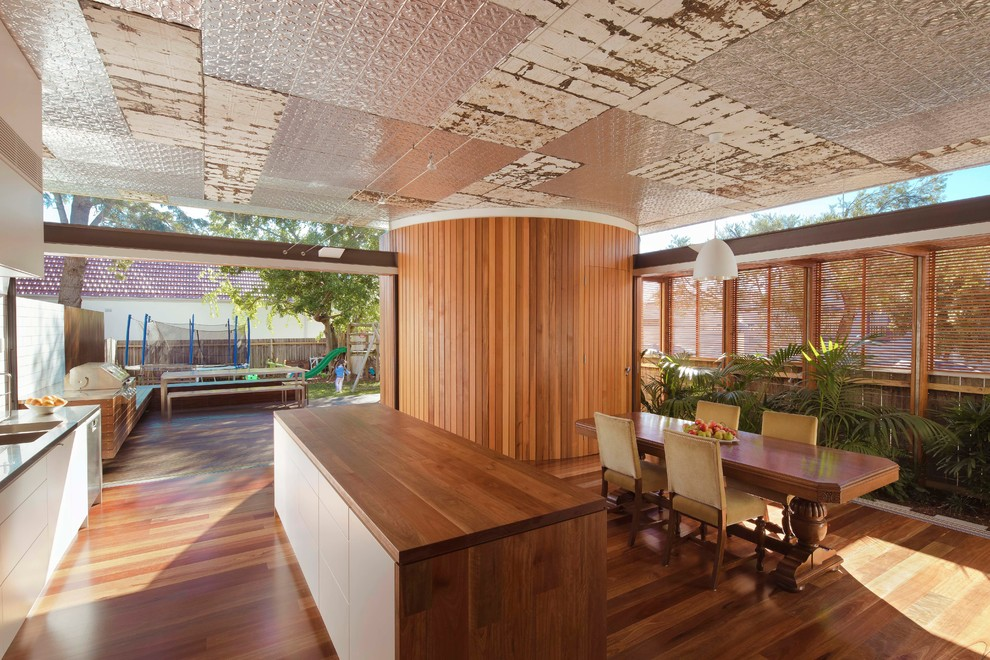 Inspiration for a contemporary light wood floor kitchen/dining room combo remodel in Sydney with white walls
