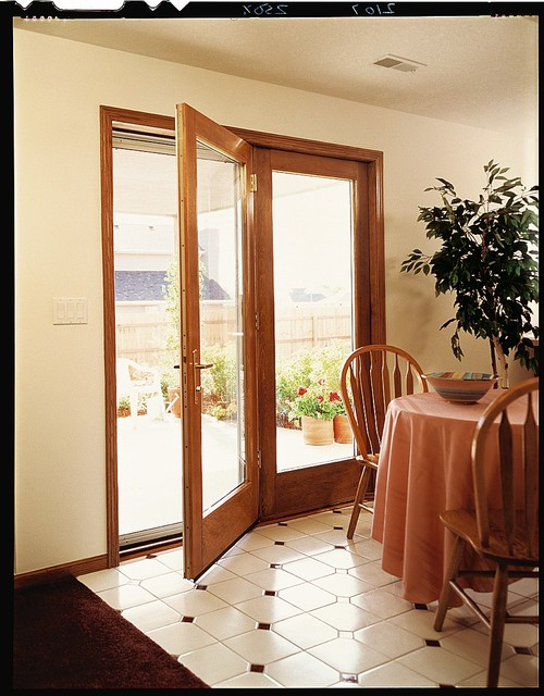 Pella® ProLine® ENERGYSTAR® Qualified Hinged Patio Doors  Traditional Dining Room