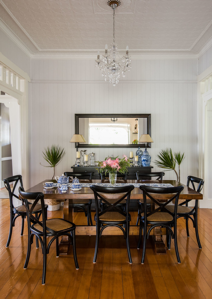 Large cottage light wood floor enclosed dining room photo in Brisbane with gray walls