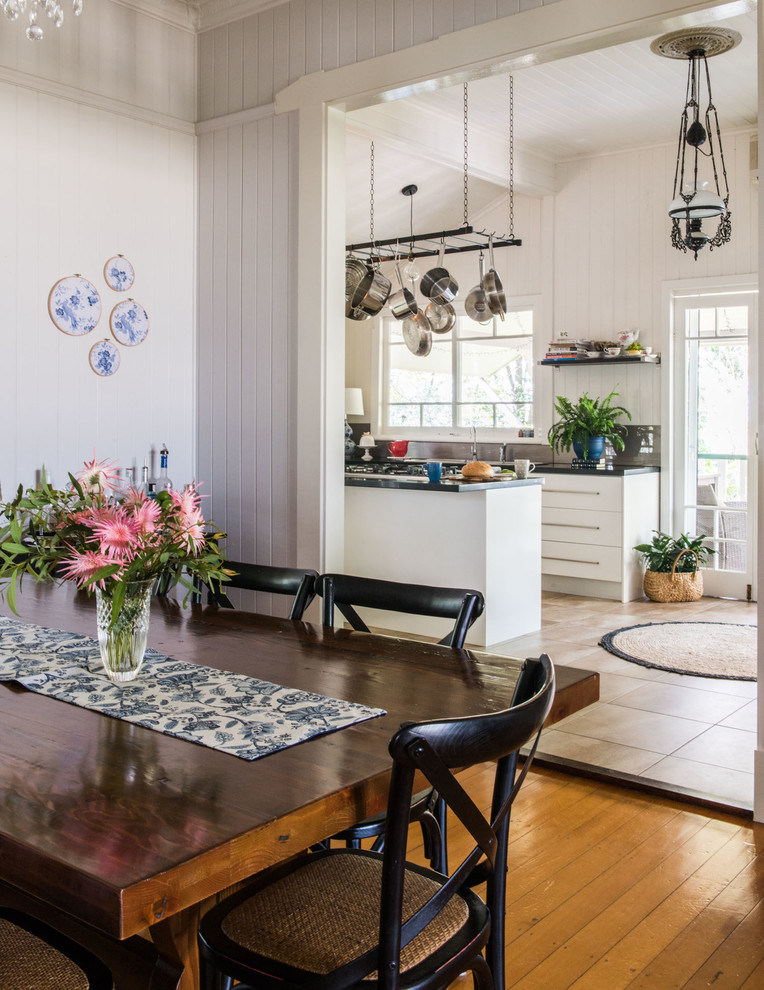 Mid-sized cottage enclosed dining room photo in Brisbane with gray walls
