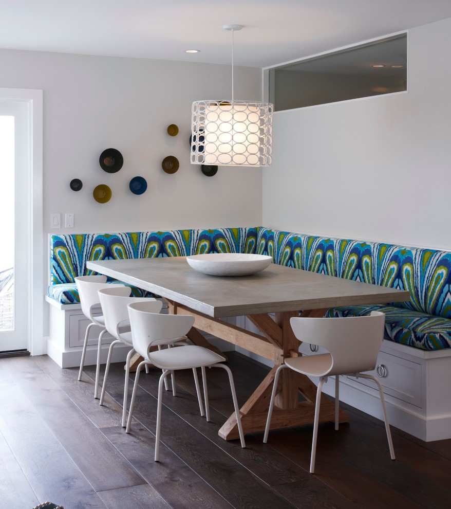 Example of a transitional dark wood floor dining room design in Orange County with white walls