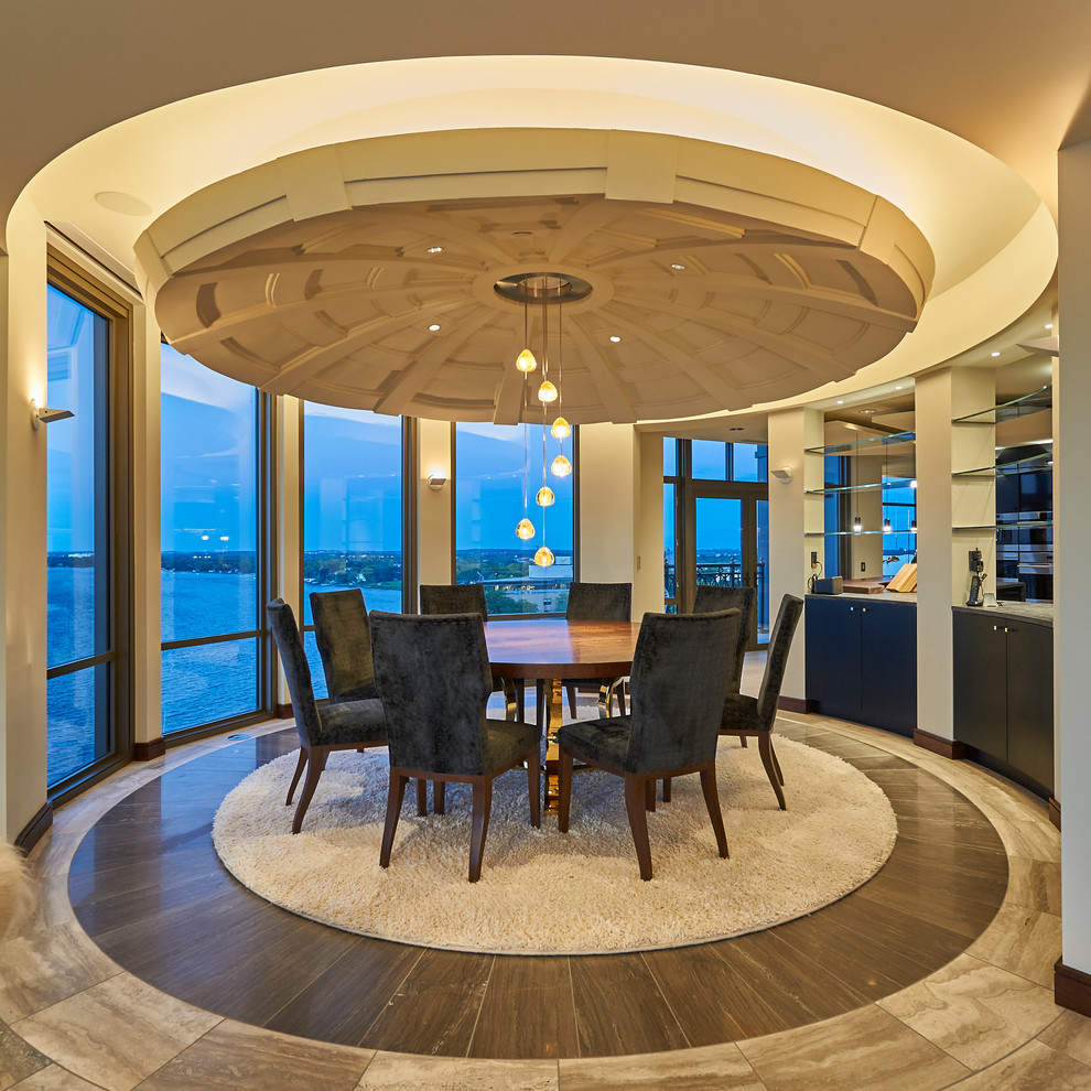 Dining room - large contemporary marble floor dining room idea in Other