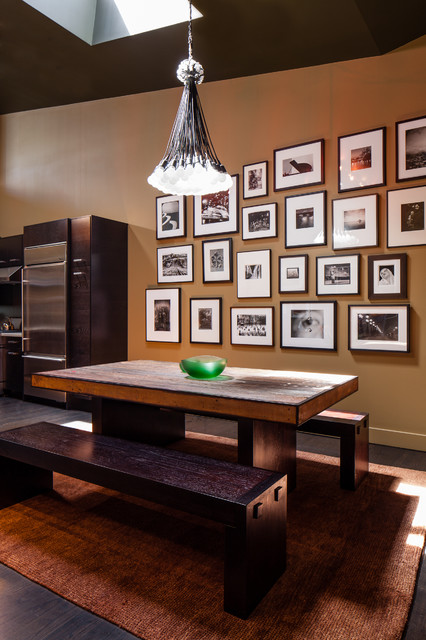Example of a trendy dark wood floor dining room design in San Francisco with brown walls