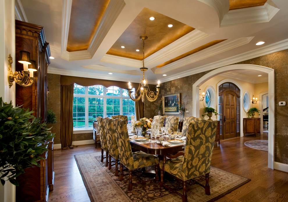 Enclosed dining room - traditional dark wood floor enclosed dining room idea in Philadelphia with brown walls
