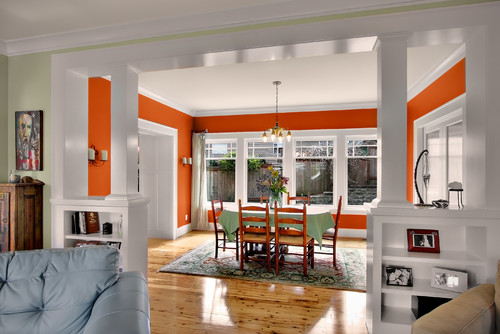 a clean white dining space with a touch of orange