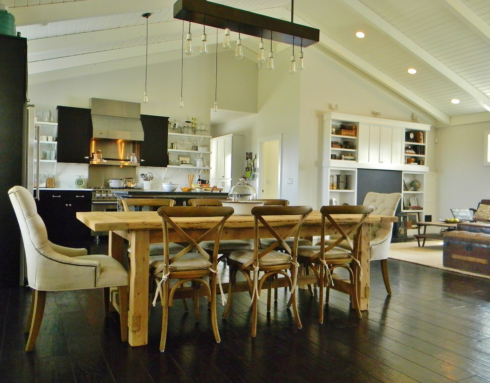 Inspiration for a cottage dark wood floor great room remodel in Seattle with white walls