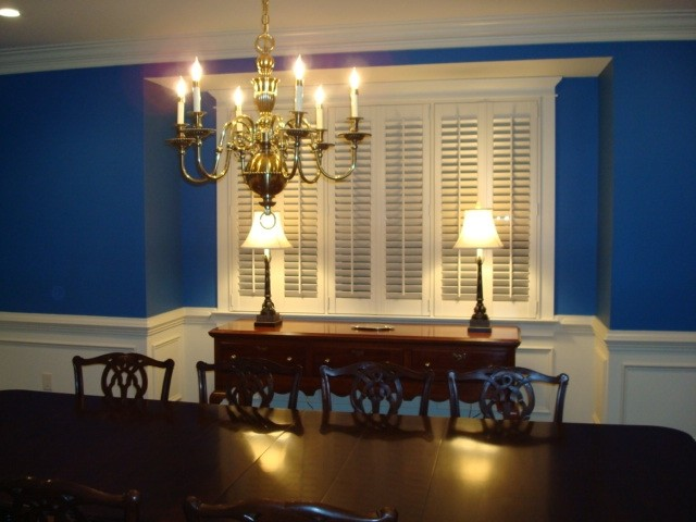 Plantation shutters grace formal dining room traditional for Formal dining room window treatments