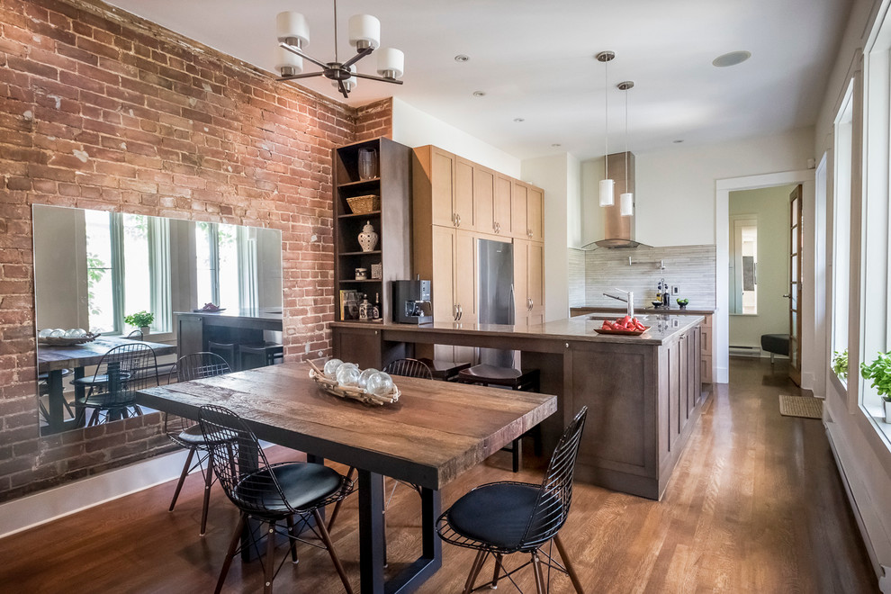 Kitchen/dining room combo - industrial dark wood floor kitchen/dining room combo idea in Montreal with white walls and no fireplace