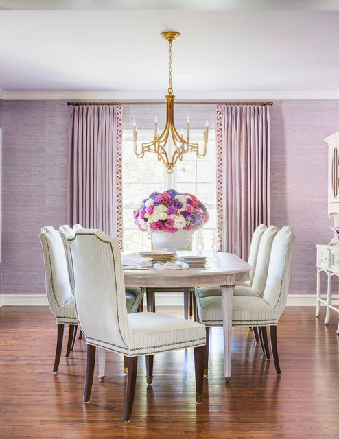 Inspiration for a mid-sized timeless medium tone wood floor dining room remodel in Little Rock with purple walls