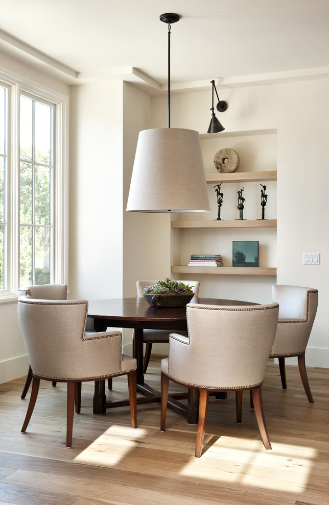 Dining room - contemporary medium tone wood floor dining room idea in San Francisco with white walls