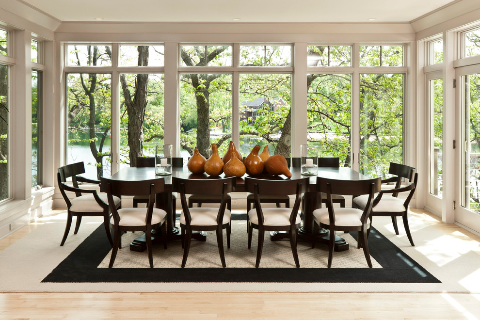 Inspiration for a contemporary light wood floor dining room remodel in Milwaukee