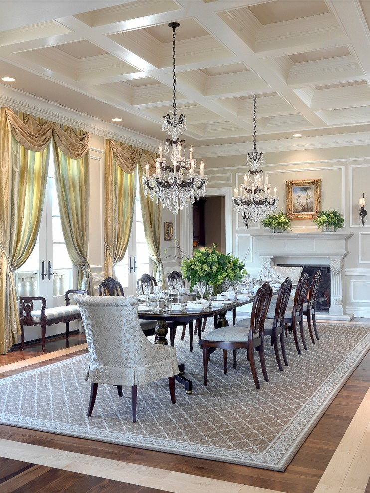 Inspiration for a timeless dark wood floor enclosed dining room remodel in St Louis with beige walls and a standard fireplace