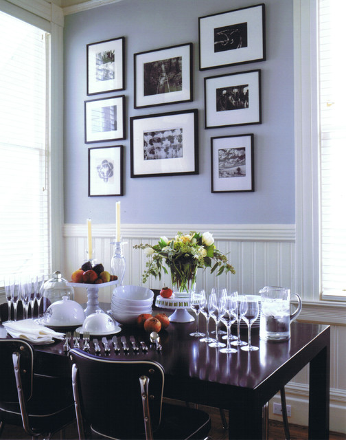 Example of an eclectic dining room design in San Francisco with purple walls